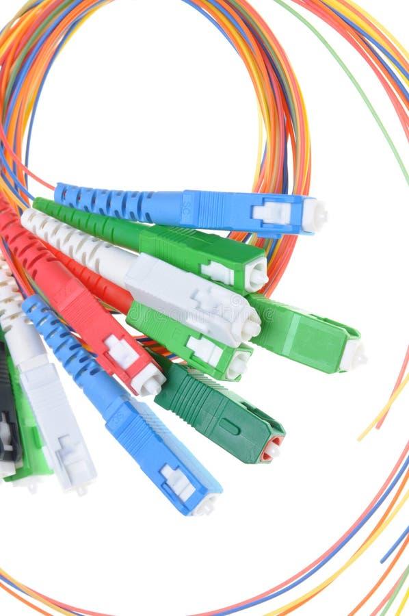 Faseroptikverbindungsstücke und -kabel stockbild