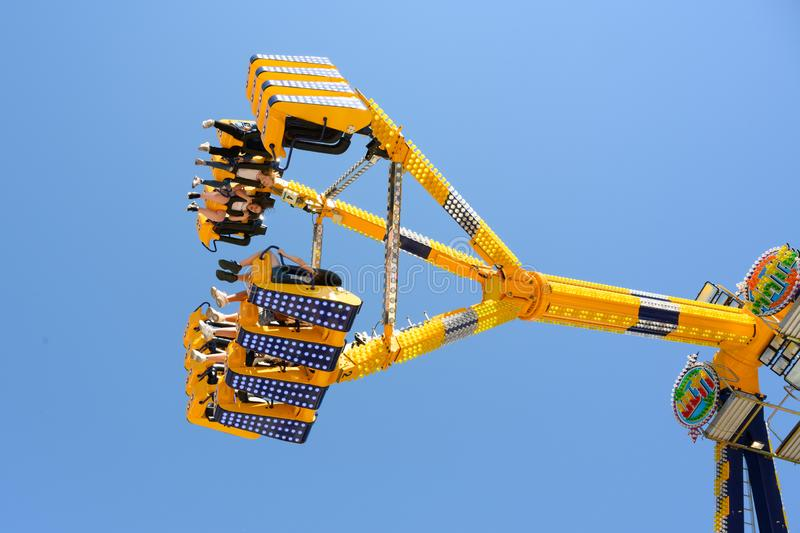 Amusement on wing, funfair ride moving on fairground stock photo