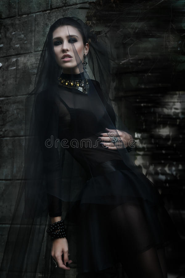Fashiom model dressed in gothic style. Vamp. Fashiom model dressed in gothic dark style. Vamp royalty free stock photo
