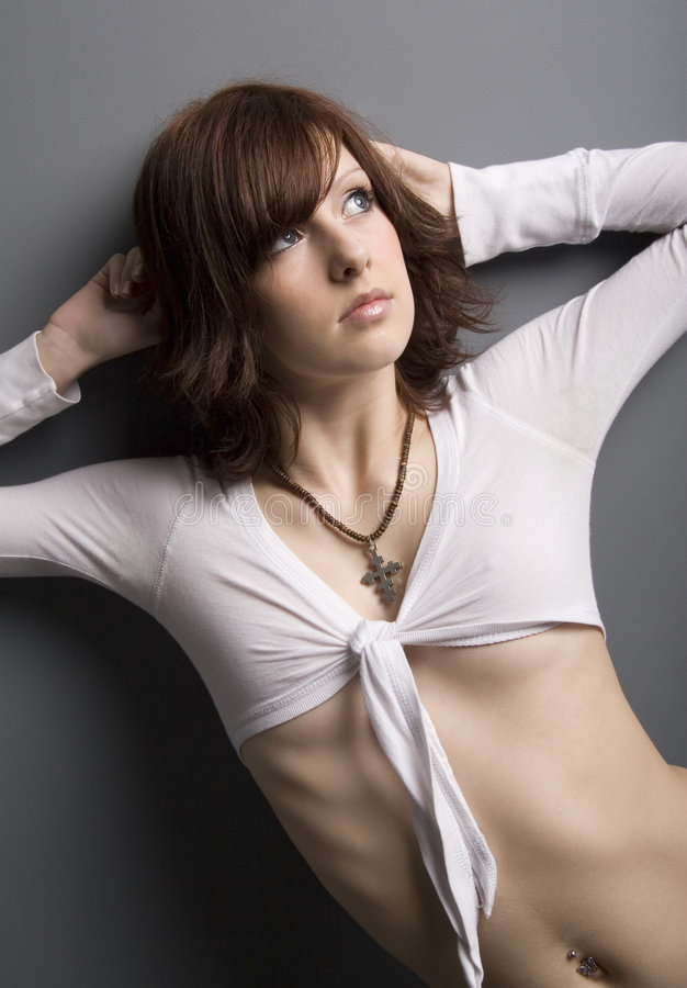 Fashion. Pretty brunette in fashion pose. lots of skin stock images