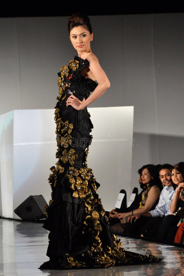 Fashion. KUALA LUMPUR - APRIL 2 :A model displays creation by Melvin Lam during STYLO Fashion Grand Prix April 2, 2009 in Kuala Lumpur stock photo