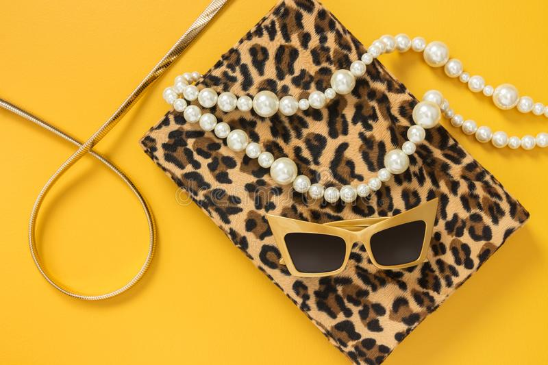 Fashion accessories on yellow background stock photography