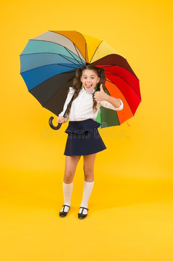 Fashion accessory. Rainy september. Accessory for rainy day. Stay dry. Fancy schoolgirl. Girl with umbrella. Rainy day. Happy childhood. Rainbow style. Kid royalty free stock images