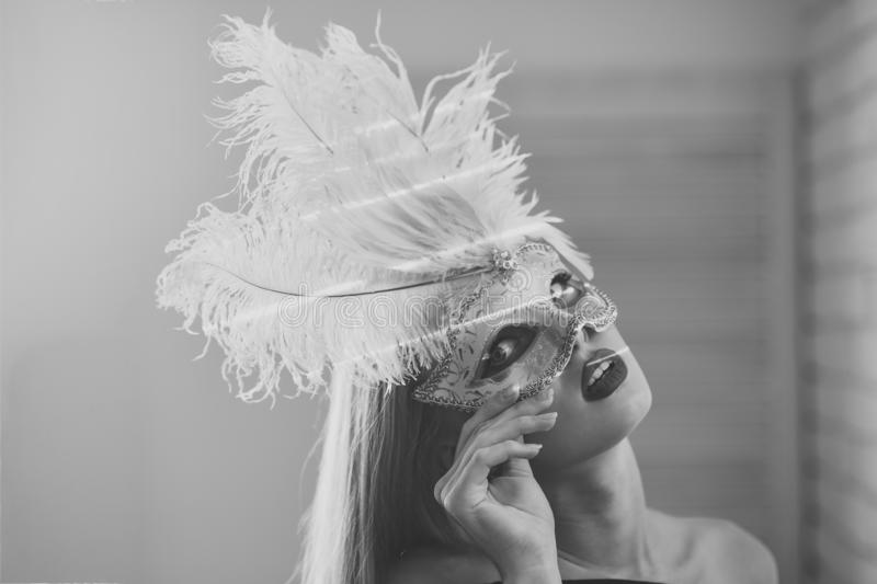 Fashion, accessory, style. Sensual woman wear carnival mask with feather, fashion. Girl with masquerade mask on face, beauty. Beauty, look, makeup. Party stock photo