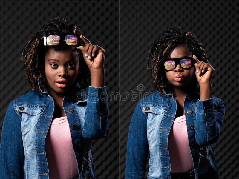 African Teenager Woman Tan skin black Afro hair. Fashion African Teenager Woman Tan skin black Afro hair beautiful high fashion make up sunglasses pink vast Jean stock photos