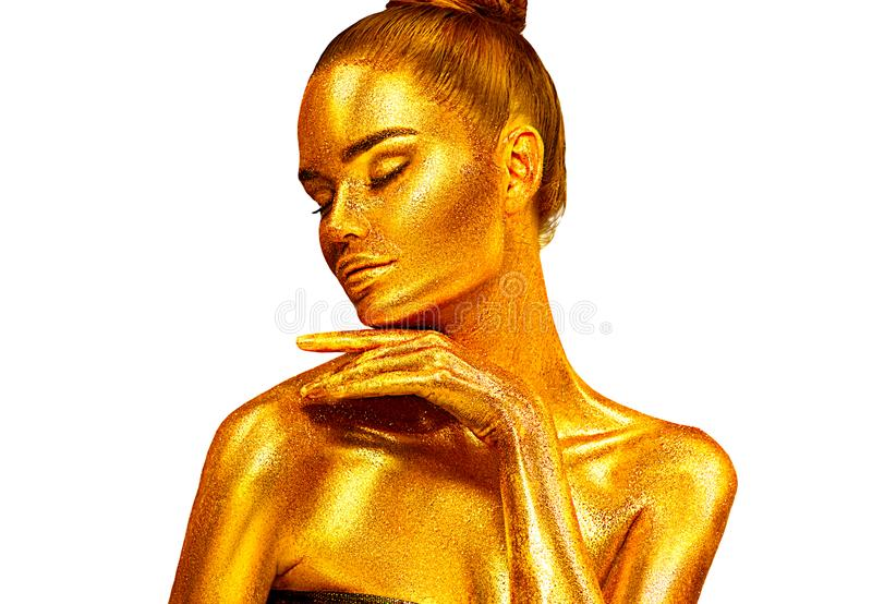 Fashion art Golden skin Woman face Beauty gold metallic body portrait isolated on white background. Christmas Model girl. With holiday golden Glamour shiny royalty free stock photo