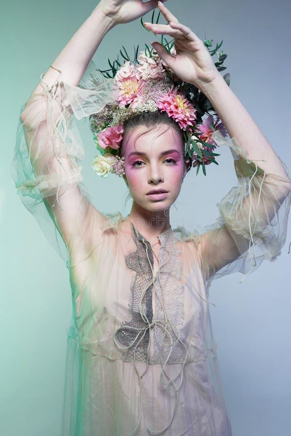 Fashion art photo of beautiful lady in flower diadem stock photo