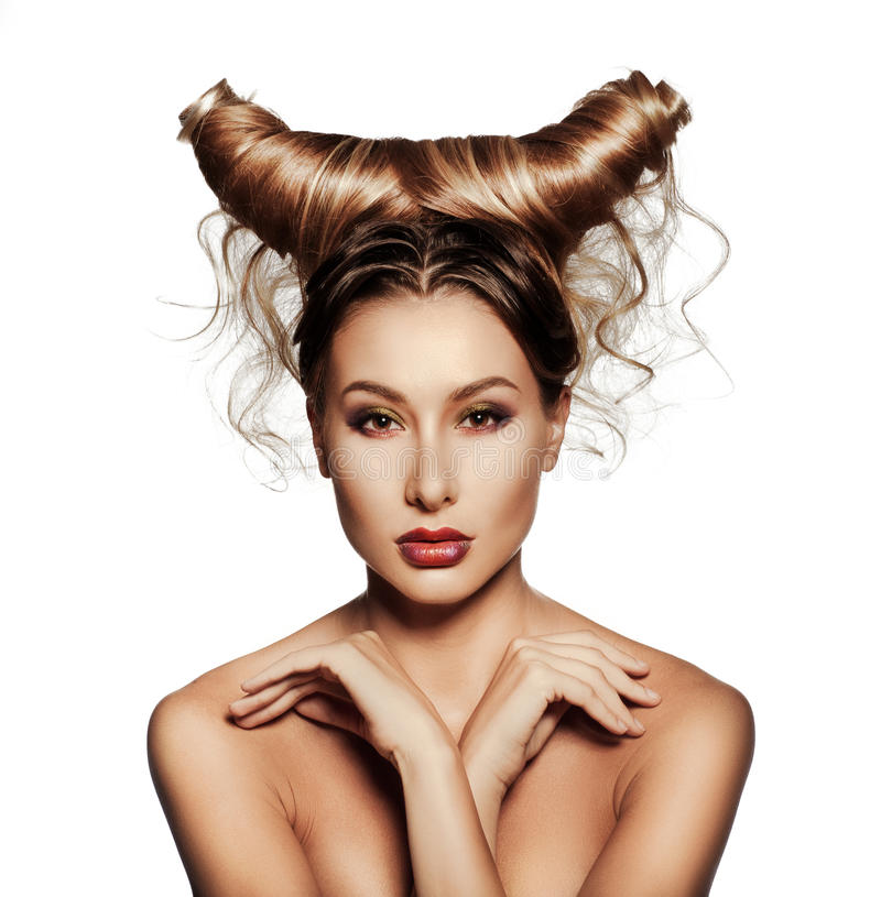 Fashion art portrait of beautiful woman with horns. stock photo