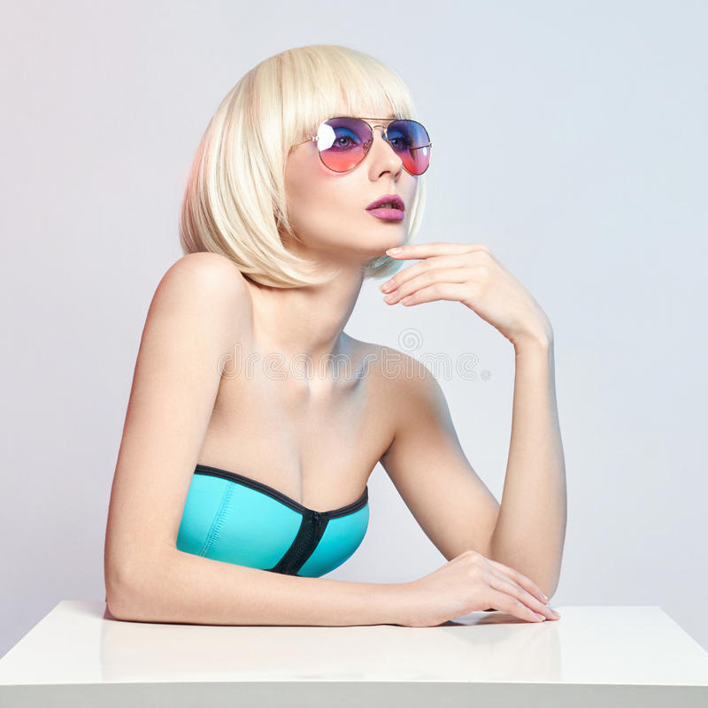 Fashion art portrait of a woman in a swimsuit with bright contrasting makeup. Creative beauty photo of a girl. On a contrasting background with colored shadows royalty free stock photography