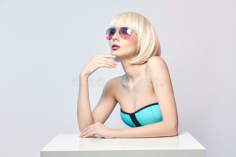 Fashion art portrait of a woman in a swimsuit with bright contrasting makeup. Creative beauty photo of a girl on a contrasting. Background with colored shadows stock photos