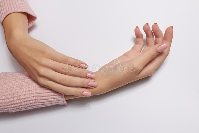 Fashion art skin care of hands and pink flowers in hands of women.  stock photo
