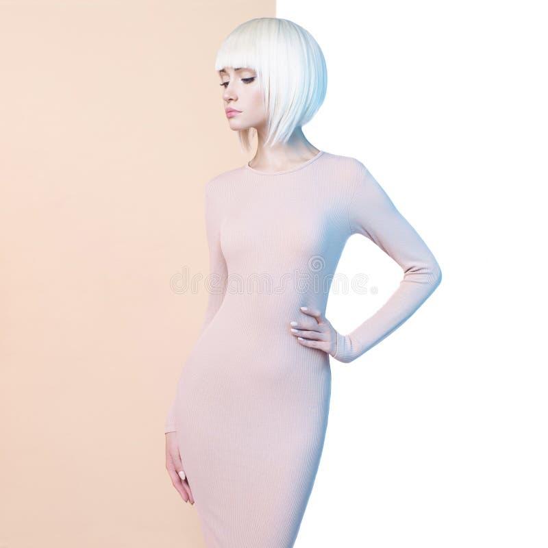 Elegant blonde in geometric beige and white background stock image