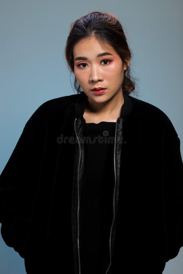 Fashion Asian Woman thin skin black hair eyes blue stock photography