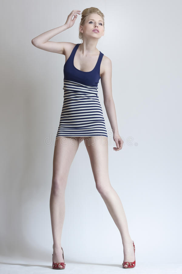 Fashion attractive girl in mini clothes royalty free stock image