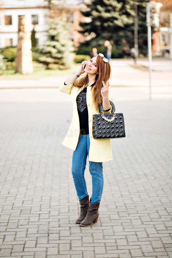 Fashion autumn portrait of stylish ginger woman, posing on the street, feminine tender smart casual outfit, vintage stock photography