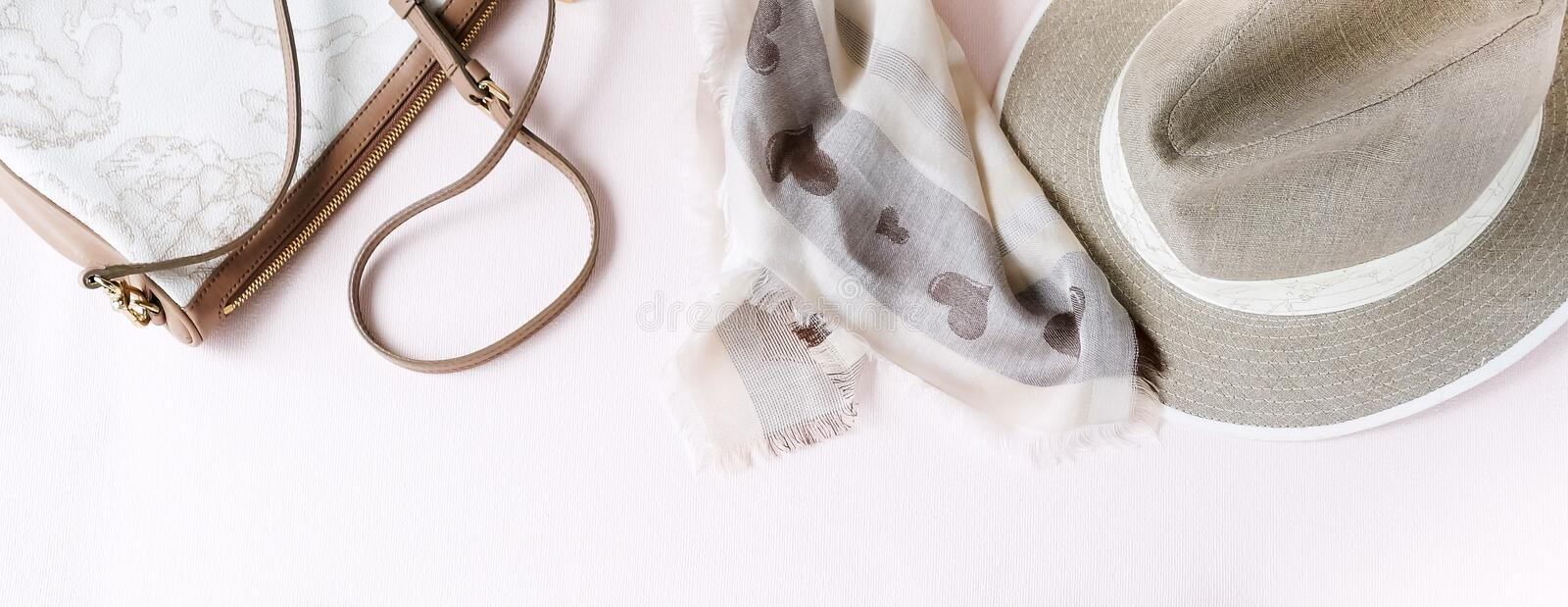 Fashion background. Female accessories in beige pastel colors stock image