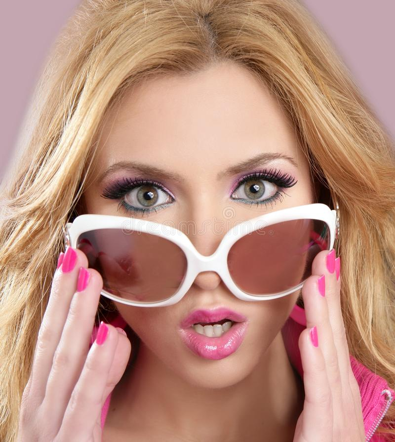 Fashion barbie doll style blode girl pink makeup. White glasses 1980s royalty free stock photography