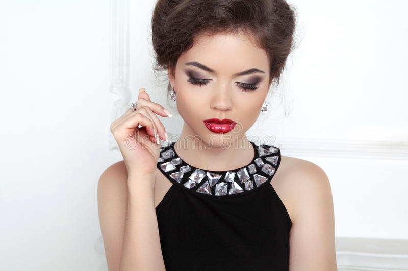 Fashion beautiful brunette young woman with makeup and luxury ne stock image