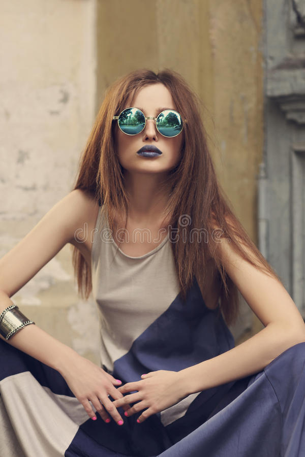 Fashion beautiful lady with blue lips in round sunglasses royalty free stock photos