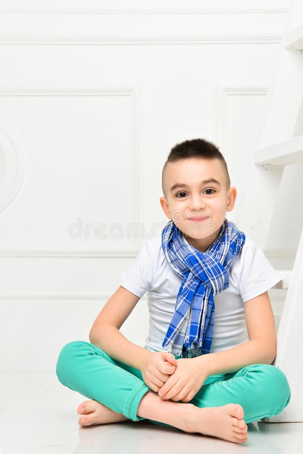 Fashion beautiful little boy in bright pants and t-shirt and scarf stock photography
