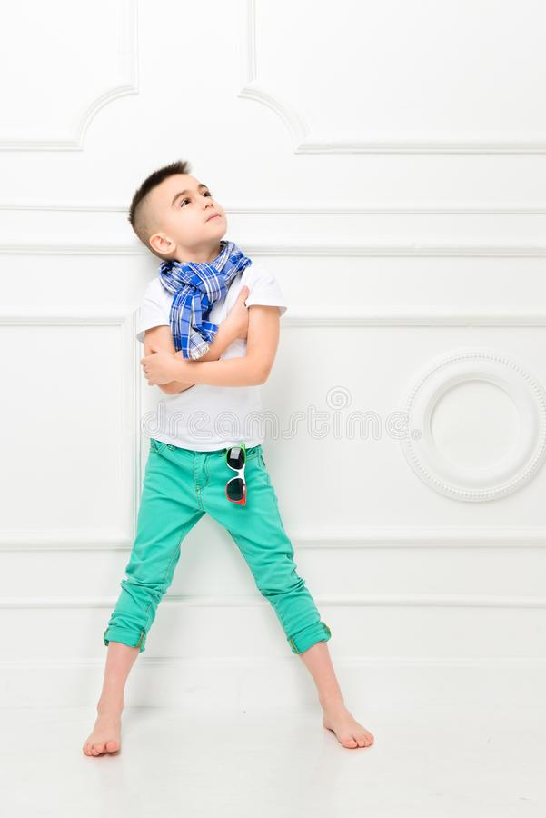 Fashion beautiful little boy in bright pants and t-shirt and scarf royalty free stock photos