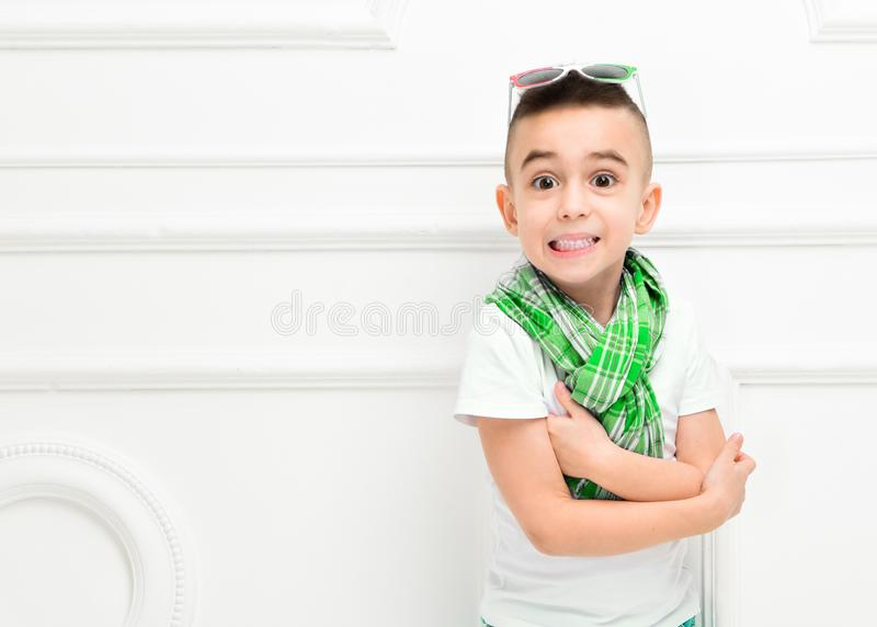 Fashion beautiful little boy in bright pants and t-shirt and scarf stock photos