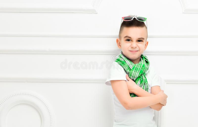 Fashion beautiful little boy in bright pants and t-shirt and scarf stock image