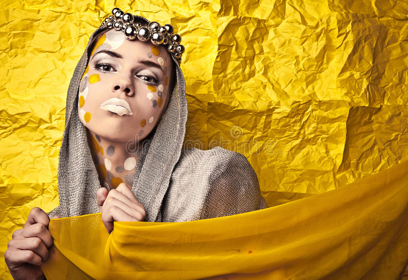 Fashion Beautiful Woman over grunge yellow background. stock images