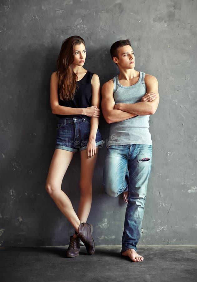 Fashion beautiful young couple stock image