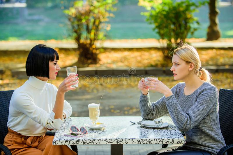 Fashion beauty. bisiness lunch. happy lunch. Enjoying morning coffee. happy friends girls meet in cafe. coffee time. Meeting in cafe. female frienship. Relax royalty free stock images