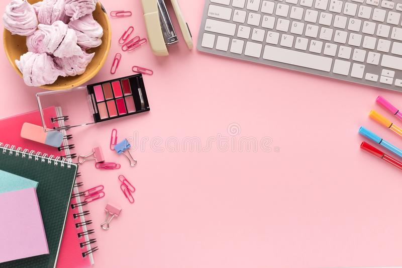Working space with keyboard on pink background royalty free stock images