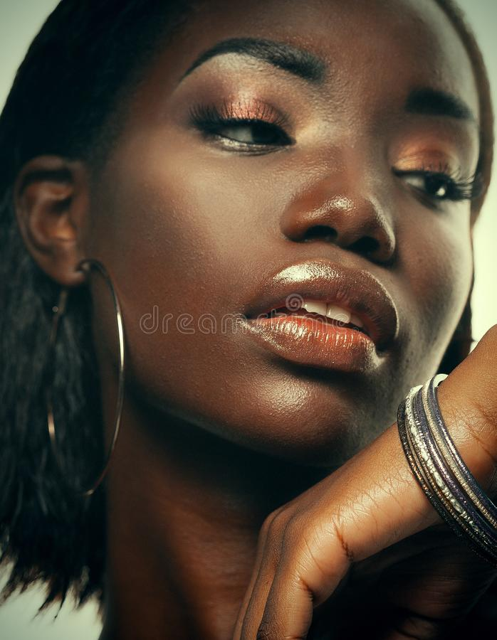 Fashion and beauty concept: attractive african american woman closeup portrait stock image