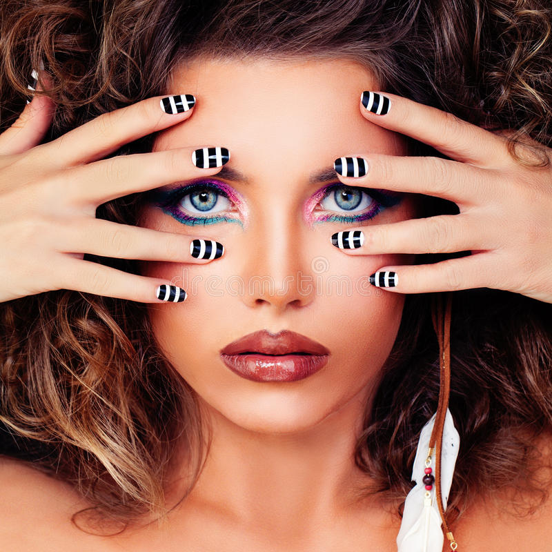 Fashion Beauty. Cute Face, Makeup and Striped Manicure Nails royalty free stock images