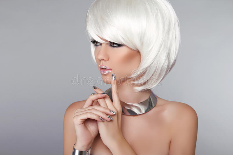 Fashion Beauty Girl. Blond Woman Portrait. Stylish Haircut and M. Akeup. Hairstyle. Make up. White Short Hair. Isolated on Grey Background. Vogue Style stock photography