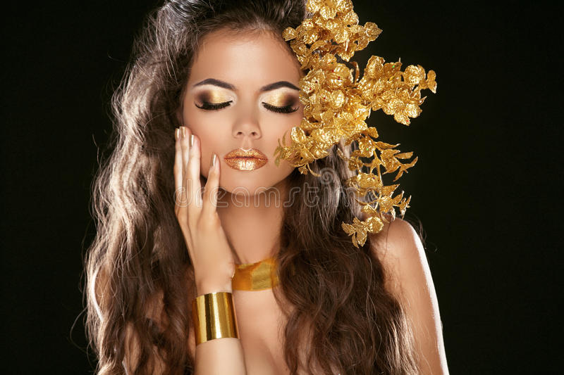 Fashion Beauty Girl Isolated on Black Background. Makeup. Golden royalty free stock image