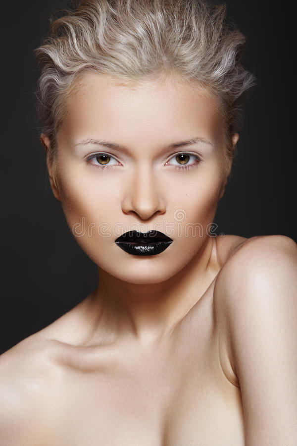Fashion Beauty. Hairstyle, Make-up & Black Lips Stock Photography