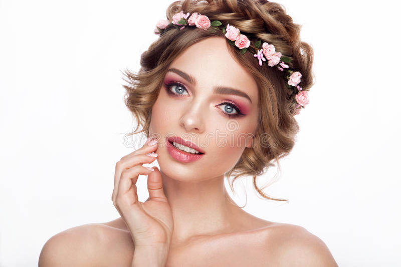 Fashion Beauty Model Girl with Flowers Hair. Bride. Perfect Creative Make up and Hair Style. Hairstyle. Beautiful Flowers stock photography