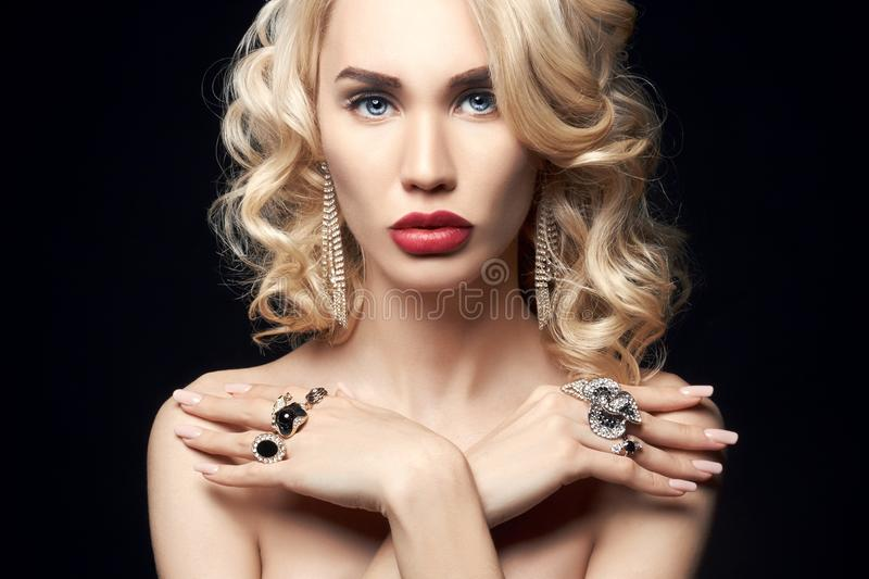 Fashion beauty Nude blonde woman on a dark background. Girl with royalty free stock images
