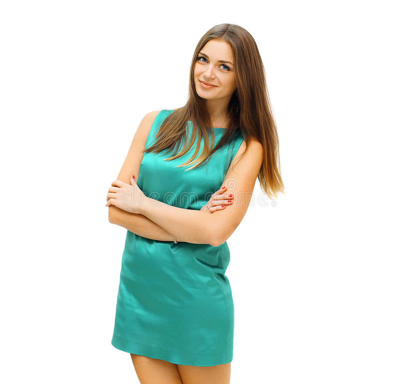 Fashion, beauty and people concept - pretty smiling woman. In green dress posing on a white background royalty free stock images