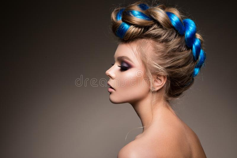 Fashion beauty portrait of a beautiful girl. With bright creative make-up and blue hair stock images