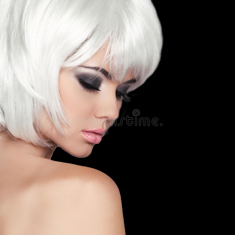 Fashion Beauty Portrait Woman. White Short Hair. Isolated on Black Background. Beautiful Girl Face Close-up. Haircut. Hairstyle. Fringe. Make-up. Vogue Style royalty free stock photography