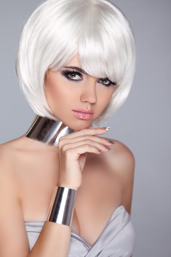 Fashion Beauty Portrait Woman. White Short Hair. Isolated on Gre. Y Background. Beautiful Girl's Face Close-up. Haircut. Hairstyle. Fringe. Make-up. Vogue Style stock photography