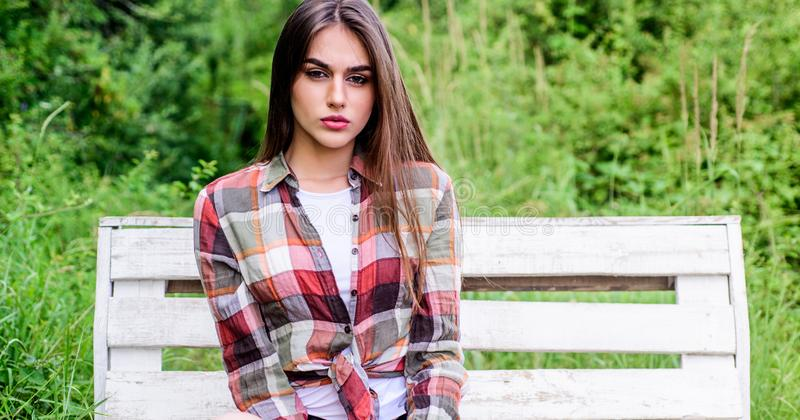 Fashion and beauty. sexy woman sit on bench. trendy summer look. girl relax outdoor in park. spring trends. hairdresser. And beauty salon. sensual fashion model royalty free stock images