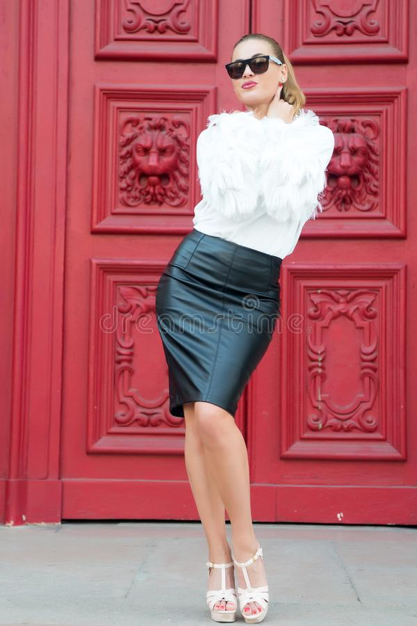 Fashion beauty and vogue. Woman in high heel shoes on red door in paris, france. woman in sunglasses with long hair. Beauty g. Irl with glamour look. Fashion royalty free stock photos