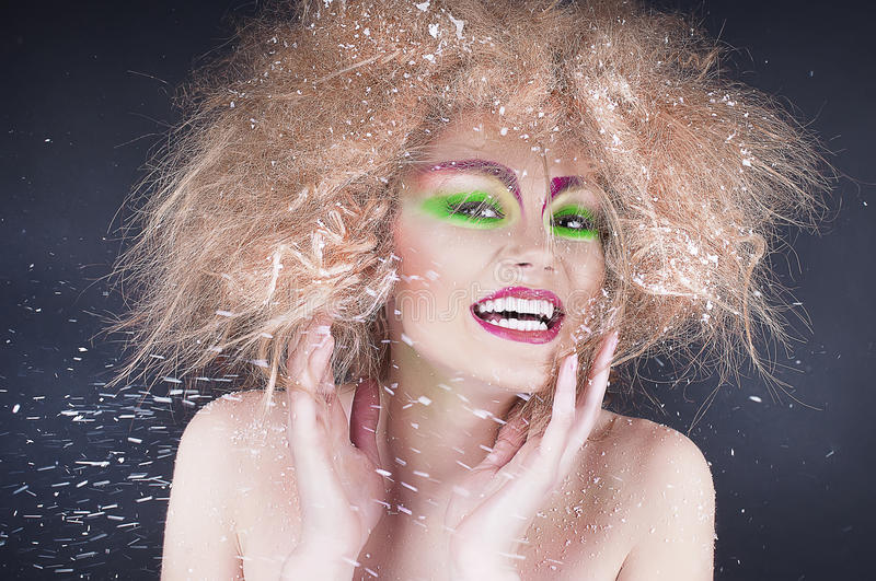 Fashion beauty woman with colorful makeup and creative hairstyle. Mood stock photo