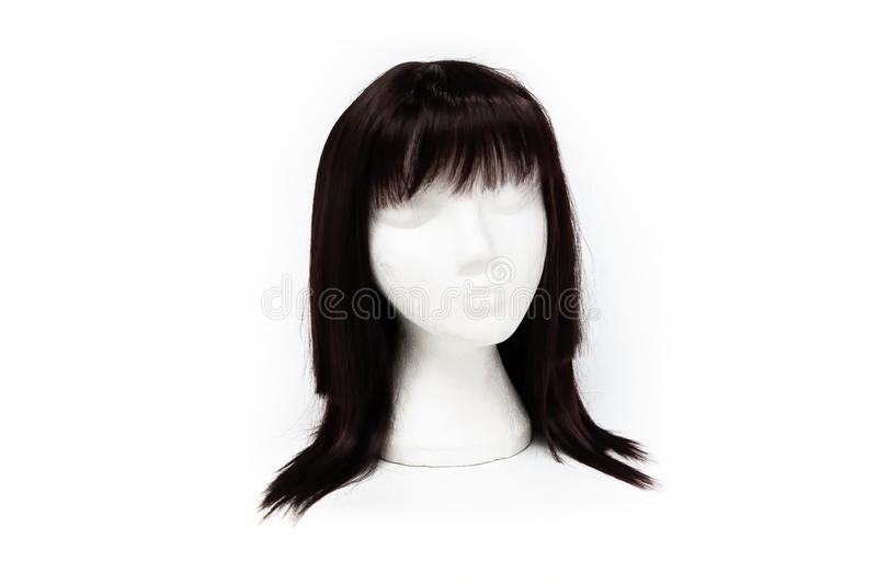 Fashion black color wig on white background royalty free stock photography