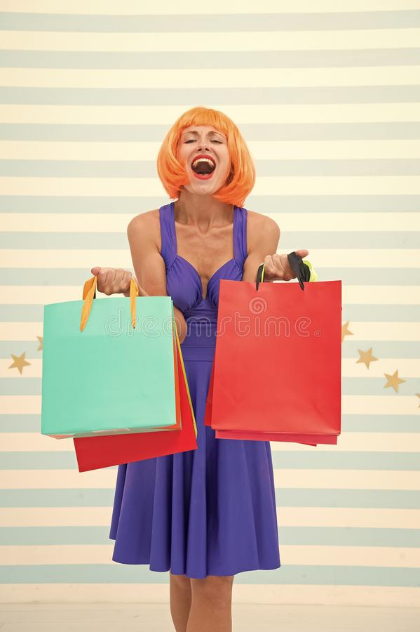 Fashion. Black Friday sales, copy space. Last preparations. big sale in shopping mall. Crazy girl with shopping bags stock image