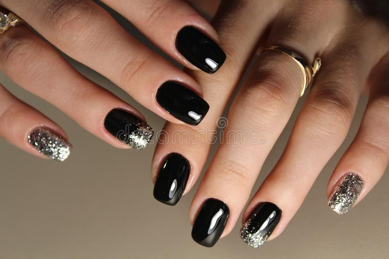 Fashion black and gold color manicure design. 2017 royalty free stock photos