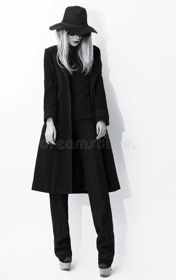 Fashion Black and white photo. Glamorous blonde in classic coat royalty free stock images