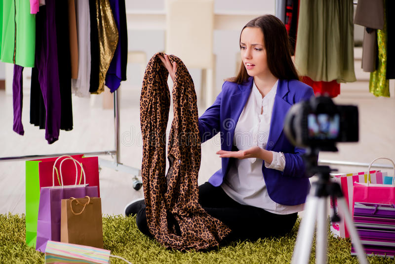 The fashion blogger recording video for blog. Fashion blogger recording video for blog royalty free stock photo